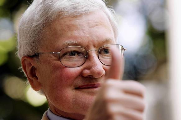 Movie critic Roger Ebert gives the thumbs-up as he arrives at a ceremony to receive a star on the Hollywood Walk of Fame in Hollywood in 2005. Ebert was the first movie critic to be honored with a Pulitzer Prize for arts criticism in 1975.