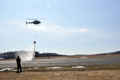 Pilot Owen Jones performs a test drop of water at the Somerset County Airport Friday morning.
