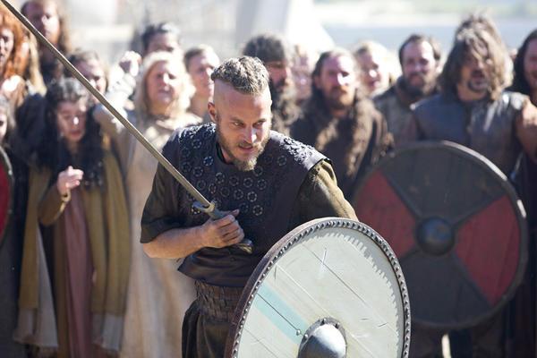 "Travis Fimmel (center) stars as Ragnar Lothbrok in History Channel's ""Vikings."""