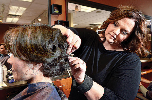 Renee Doub, right, creates a vintage Hollywood hair style on Stacey Durning at Bella Salon & Spa. The salon is having an Evening of Hope-Fashion for a Cure Saturday, April 13, at The Maryland Theatre.