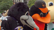 "Orioles fans stood and applauded Friday as an image of Joe Flacco hoisting the Lombardi Trophy flashed on the video board at Camden Yards, part of an Opening Day tribute to the <a href=""http://www.baltimoresun.com/superbowl/"">Super Bowl</a> champion Ravens."