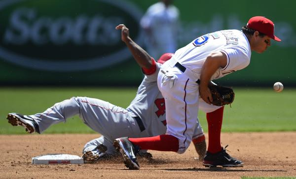 Angels second baseman Howie Kendrick slides safely into second base on a steal as Rangers second baseman Ian Kinsler fields the throw in the second inning Friday.
