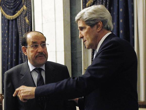 Secretary of State John Kerry (right) meets with Iraq's Prime Minister Nouri al-Maliki on March 24 in Baghdad, where he failed to get a commitment from al-Maliki to make sure Iranian flights over Iraq do not carry arms and fighters to Syria.