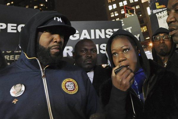Sybrina Fulton and Tracy Martin, left, the parents of Trayvon Martin, speak at a protest on the anniversary of their son Trayvon's death in Union Square Park in New York.