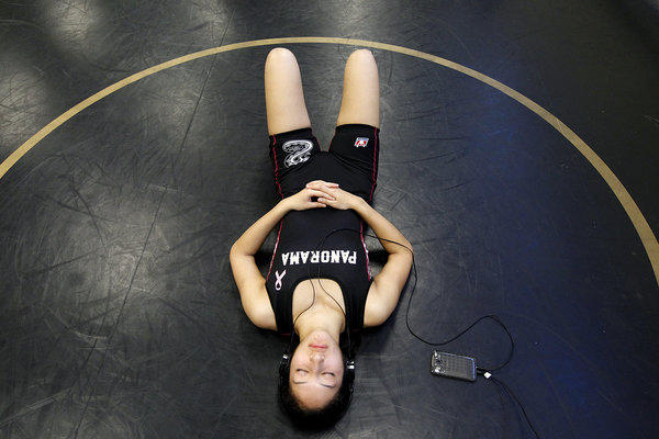 Panorama High wrestler Diana Oliva listens to boy band One Direction before a home match.