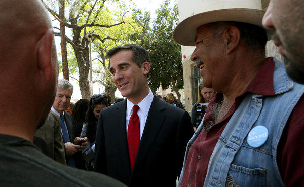 Los Angeles mayoral candidate Eric Garcetti mingles with his supporters.