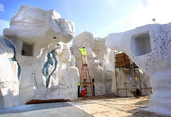 Simulated ice is painted on during a construction tour of SeaWorld's Antarctia: Empire of the Penguin attraction, which is set to open May 24, 2013.