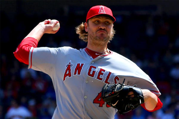 Angels' Kevin Jepsen pitches in the seventh inning against the Texas Rangers.
