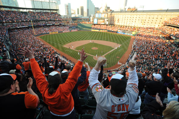 Fans react to Adam Jones' single that tied up game in eventual win for the Orioles against the Twins in the home opener.