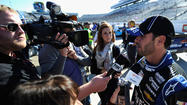 Jimmie Johnson has won the pole position for Sunday's NASCAR race at Martinsville Speedway with a track record.