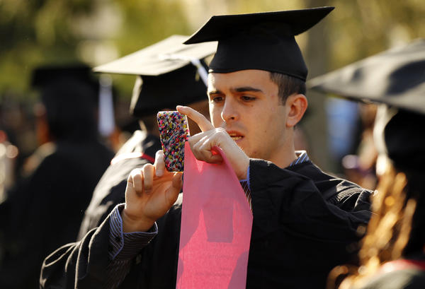 The wages of recent college graduates have fallen over the last decade. Above, a student during graduation at Cal State University Northridge.
