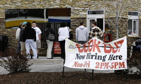 Job seekers line up outside a restaurant in Richmond, Va. Restaurants were among the industries continuing to bulk up last month.
