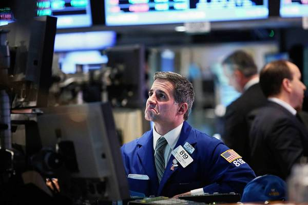Stocks were sent on a bit of a roller-coaster ride Friday. The Dow Jones industrial average was down nearly 172 points early in the session, but some investors took advantage of the steep drop to cherry-pick stocks. The blue-chip index closed down 40.86 points, or 0.3%, at 14,565.25. Above, a trader works on the floor of the New York stock Exchange.