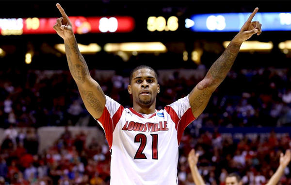 Louisville's Chane Behanan (21) celebrates in the final minute against the Duke.