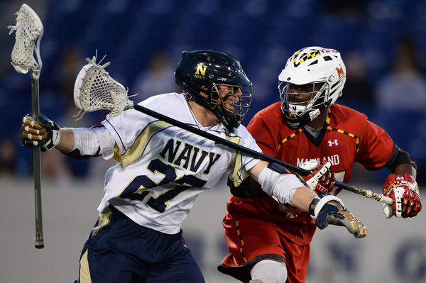 Navy attackman Sam Jones gets by Maryland defenseman Goran Murray in the first quarter.