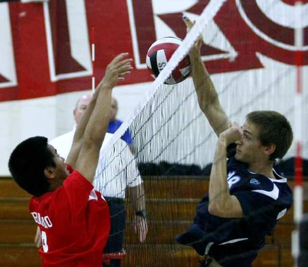 Glendale High's #9 Victor Bernardino, left, blocks a kill by Crescenta Valley High's #18 Freedom Tripp, right, during home game in Glendale on Friday, April 5, 2013. (Raul Roa/Staff Photographer)