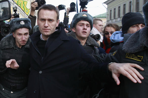 Opposition leader Alexei Navalny is detained by police during a protest march in Moscow.