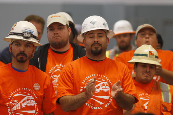 IBEW union members applaud while they show their support for BNSF Railway's proposed Southern California International Gateway (SCIG) facility during a public hearing by the Los Angeles Harbor Commission in San Pedro.