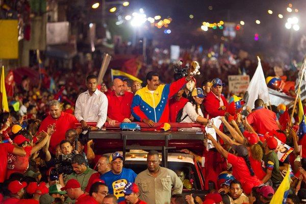 Bathed in the primary colors of the Bolivarian Socialist Revolution launched by the late Hugo Chavez, Venezuela's acting president, Nicolas Maduro, has been campaigning to succeed Chavez by claiming to be guided by his spirit.