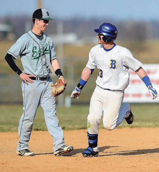 South Hagerstown's Colby Johnson, left, and Clear Spring's Dylan Stouffer exchange smiles while Stouffer rounds the bases on a first-inning home run Friday.