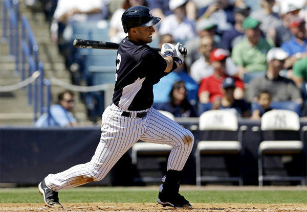 Yankees' Derek Jeter hits a single during a spring training game against the Miami Marlins.