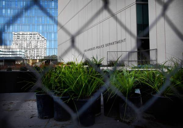 A fence blocks access to part of the grounds at LAPD headquarters that is being re-landscaped. The city is plowing $400,000 into the latest upgrade.