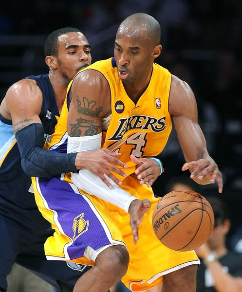 Memphis Grizzlies guard Mike Conley fouls Lakers guard Kobe Bryant.