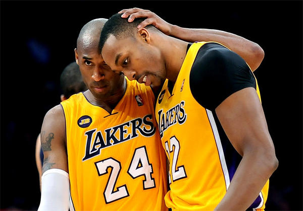 Lakers guard Kobe Bryant (24) hugs center Dwight Howard after Howard made one of two free throws late in the game against the Memphis Grizzlies.