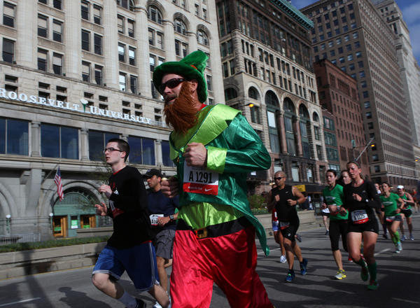 A colorfully-garbed runner travels south on Michigan Avenue during the Bank of America Shamrock Shuffle on Sunday. Approximately 34,000 runners participated in the 8K race, which is celebrating its 33rd anniversary in Chicago.