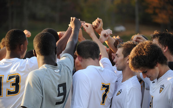 Towson soccer players huddle after their final game. The program was a victim of budget cuts.