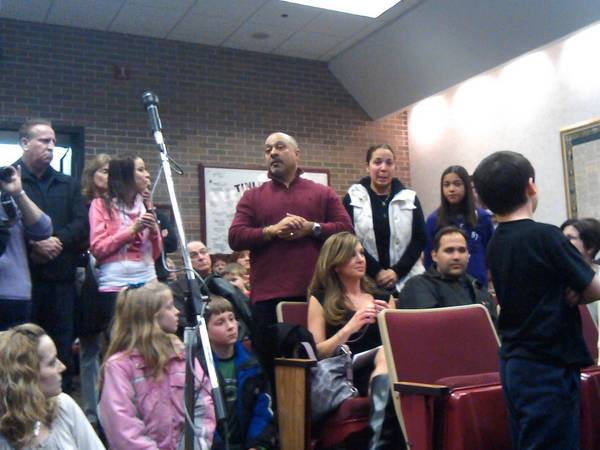 The Miranda family--father Luis (center in the maroon shirt), mother Ivonne (in the white vest), and daughter Sarah (in blue), attended the April 2 ceremony where the emergency response workers who helped save Sarah, 12, and Nicole Salwierak, 11, from a sink hole Dec. 2, were honored by Tinley Park officials.