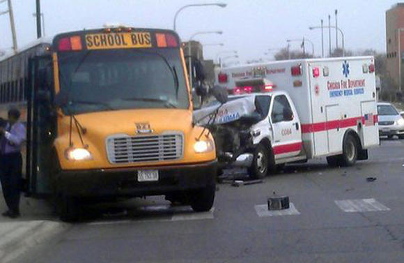 Ambulance and school bus crash in Chicago