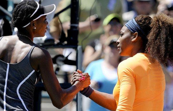Serena Williams, right, shakes hands with her sister Venus Williams after her 6-1, 6-2 victory on Saturday in the semifinals of the Family Circle Cup tennis tournament in Charleston, S.C.