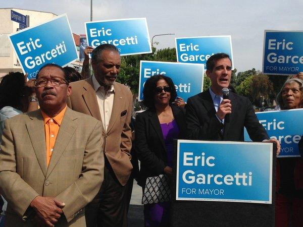 Mayoral candidate Eric Garcetti speaks at a rally in Leimert Park with Herb Wesson, left, Bernard Parks and Jan Perry. The three City Council members endorsed Garcetti.
