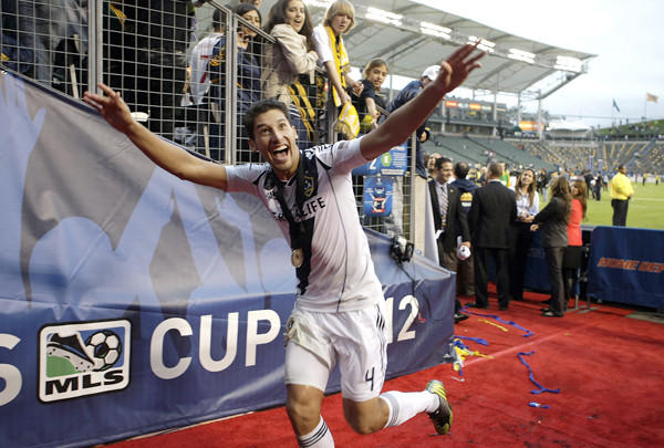 Galaxy defender Omar Gonzalez waves to fans after the Galaxy won the MLS Cup championship game last season.