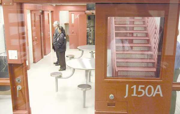 ARCHIVE PHOTO: Rish Wells, left, and officer Leticia Chang, take a look at some of the jail's cells.