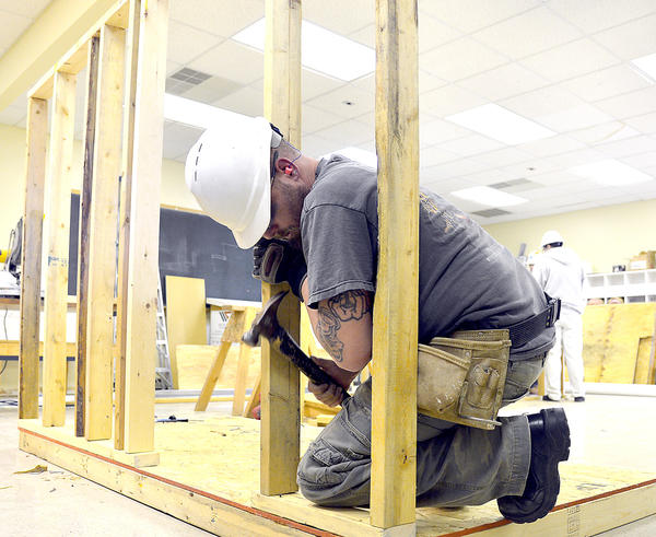 Philip Long of Thurmont frames a wall for structure Saturday during 2013 Associated Builders & Contractors Skills Competition at Barr Construction Institute.