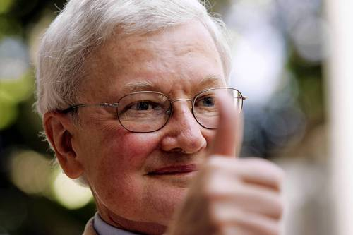 Movie critic Roger Ebert gives the thumbs-up as he arrives at a ceremony to receive a star on the Hollywood Walk of Fame in Hollywood in 2005.