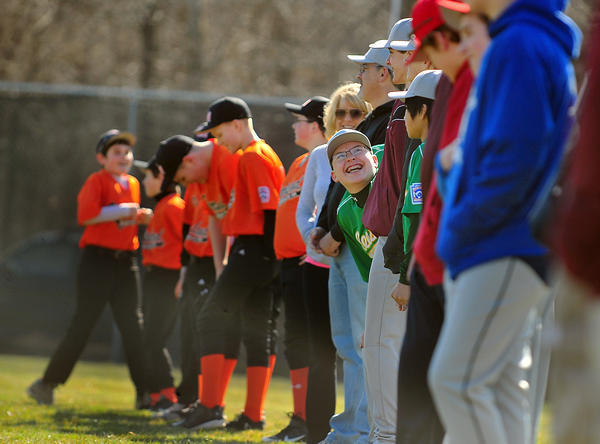 Players line up for the parade of teams Saturday during South Mountain Little League opening day in Boonsboro.