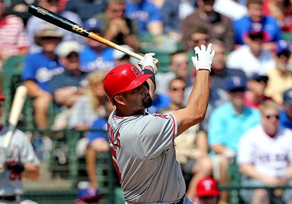 Albert Pujols belts a two-run home run against the Texas Rangers.