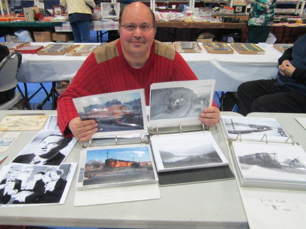 Phil Soyring of Brunswick, Md., shows some of the photos he had on display Saturday at the Bunker Hill Train Club Show at the Ranson (W.Va.) Civic Center.