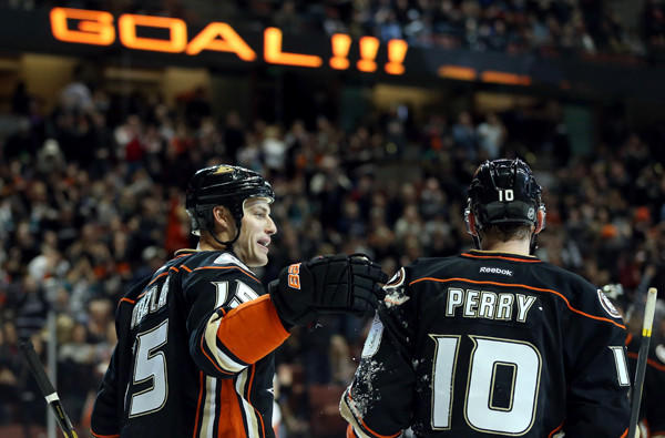 Ducks teammates Ryan Getzlaf and Corey Perry celebrate a goal by Getzlaf during a 4-0 victory over the Calgary Flames last month at the Honda Center.