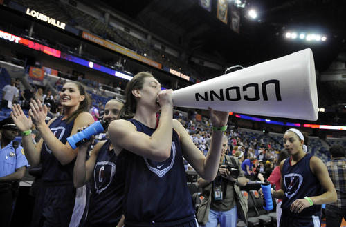 UConn's Breanna Stewart yells into a megaphone at the end of practice at the NCAA women's Final Four in New Orleans. UConn takes on Notre Dame in a national semifinal game Sunday night.