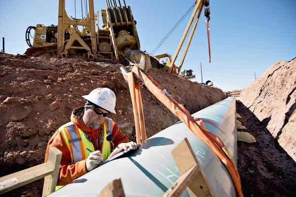 Construction is underway on a pipeline to connect Cushing, Okla., to Nederland, Texas. It would be part of the Keystone XL pipeline project.