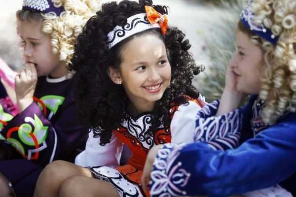 Meehan Kono, 10, center, talks to Savannah Robinson, 11, right, before participating in Burbank on Parade, which took place on Olive Avenue, between Keystone and Lomita streets, in Burbank on Saturday, April 6, 2013.