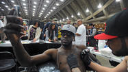 Ravens wide receiver LaQuan Williams sat calmly at the Baltimore Convention Center on Saturday as a tattoo artist buzzed at his shoulder, sketching out the latest design on the already well-inked torso.