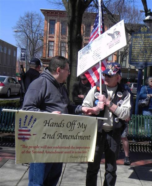Keith Reh,left, of Palmyra, Pa., and Bob Cini, of Lower Paxton, Pa., were among 250 ralliers who attended Saturday's Second Amendment Freedom Rally on Courthouse Plaza in Chambersburg, Pa., in support of their right to bear arms.