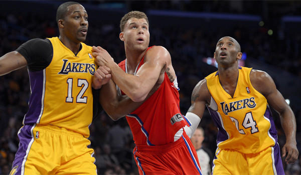 Lakers center Dwight Howard, left, and guard Kobe Bryant -- shown flanking Clippers forward Blake Griffin -- developed an on-court chemistry as the season progressed, and their personal relationship has grown recently, too.