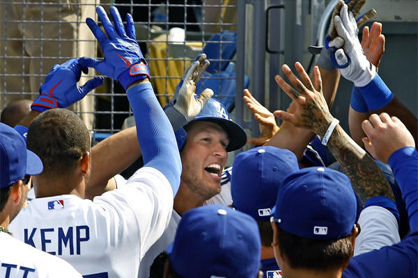 Special moments like Dodgers pitcher Clayton Kershaw's opening-night home run wouldn't happen anymore if the National League started using designated hitters.