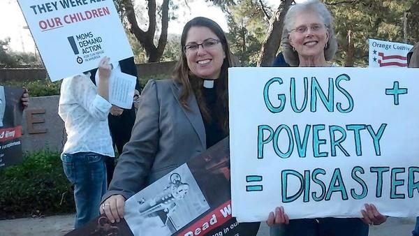 Rev. Dr. Sarah Halverson, pastor at Fairview Community Church, and Marlene Gillespie, of Irvine, stand at the corner of Sunny Hill and Shady Canyon during Thursday's rally.